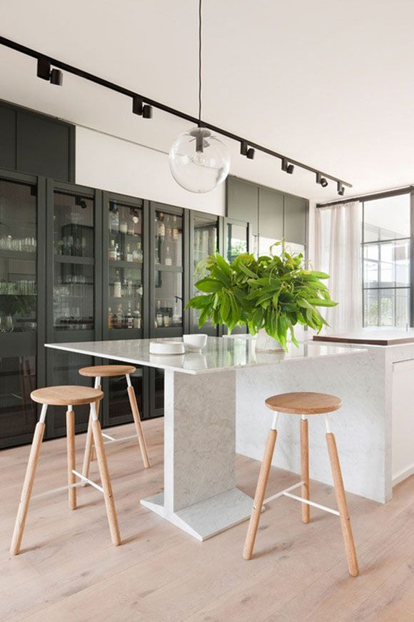 Kitchen Dreams. A modern kitchen island with seating. Interior Design by Hecker Guthrie with Ridolfi Architects.