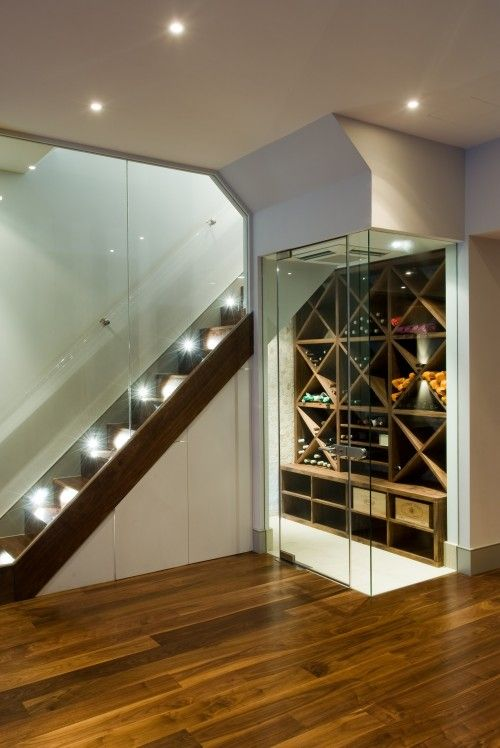 I really really want to do this under the stairs when we finish the basement!  Doesn't take too much space, and can store wine.