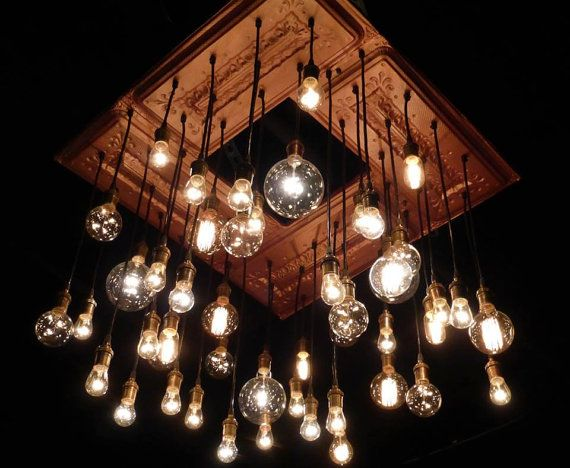 Antique Ceiling Tins Repurposed into Chandelier Light Fixture with Pendant lights