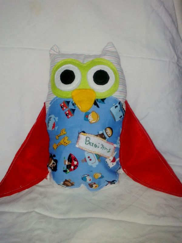 Handmade owl pillow. It's made by cotton fabric and felt details and a name detail of the owner.