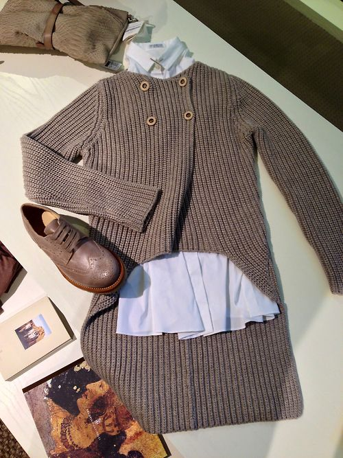 This double breasted spring Brunello Cucinelli sweater with a long tail is one of the highlights of the women's delivery.