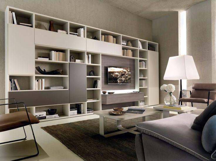 Vuoi coprire un muro con I tuoi mobili? GSG04, un modello in bianco e rovere scuro con posto per diversi accessori e posto per I libri.