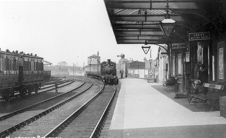 Looking towards Birmingham as a four-carriage commuter train arrives at Harbornes single platform terminus