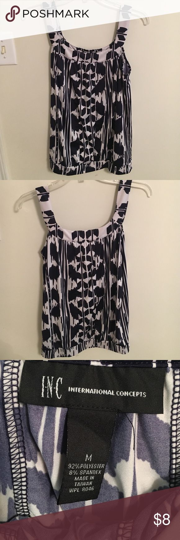 Dark Navy Blue and white blouse Dark Navy blue and white blouse. Blouse is too loose and big on my body. The pattern looks black but it is a dark Navy blue. Blouse is medium and only has been worn once. INC International Concepts Tops Blouses