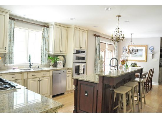 Cream colored cabinets with a more neutral gray wall for Neutral colors for a kitchen