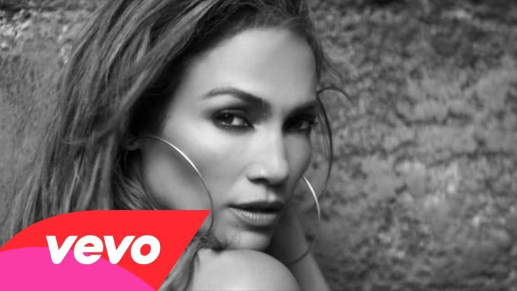 """Jennifer Lopez lights up the screen wearing a shimmering full-length dress embellished with 300,000 Swarovski crystals designed by couturier Vrettos Vrettakos in her video for her single """"First Love""""."""
