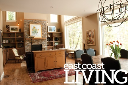 This home boasts an open-concept space for the kitchen, living and dining areas. Huge windows showcase the lush trees and forest just beyond the walls. Featured in the Summer 2012 issue of East Coast Living. Photo by Joanna Nickerson, Studio Rouge