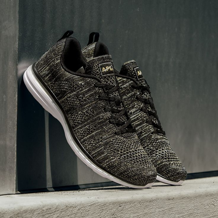 The APL® TechLoom Pro in Black/Gold/Silver is a world first featuring a mélange of black, metallic silver and metallic gold all woven together creating one amazing shoe. Perfect for the gym and the street, the one piece woven upper is composed of innovative performance textiles to create a truly intriguing visual. Cushioning is provided by the proprietary APL Propelium® midsole/outsole for extreme comfort and clean looks. The TechLoom Pro is truly whe...