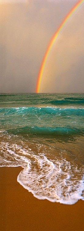 rainbow into sea
