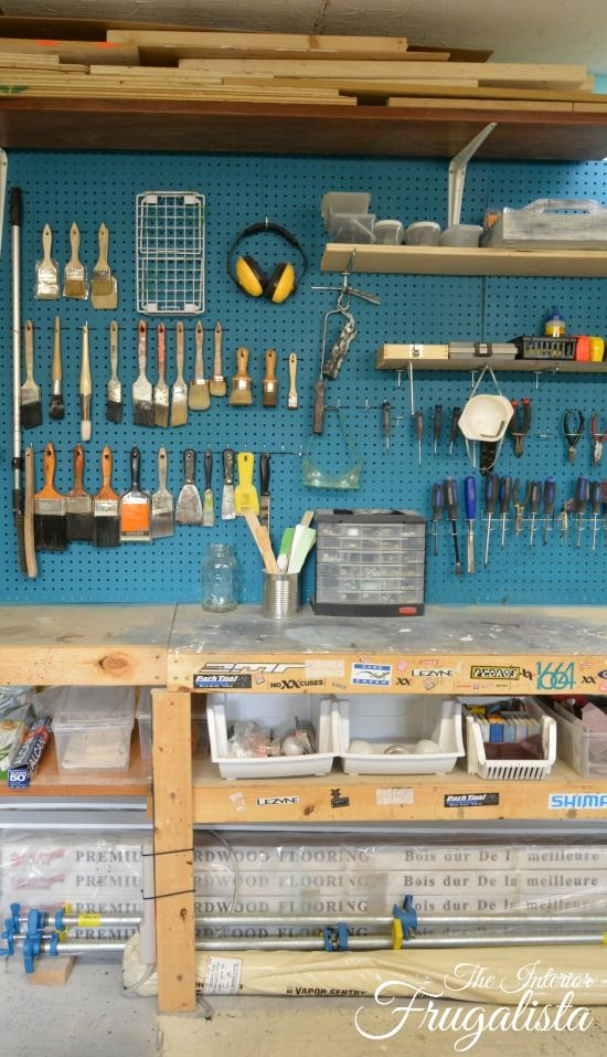 An organized Basement Workshop with Paint Brush Pegboard storage and DIY Workbench|The Interior Frugalista
