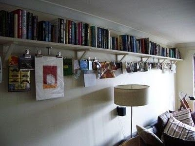 IKEA Hackers: Dignitet: Book up top, rail below. Using bulldog clips to attach stuff to rail.