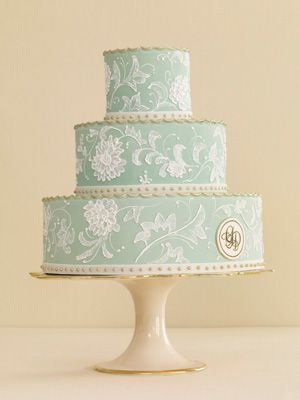 Green Floral Wedding Cake    To get a wedding cake like this one (with rolled fondant, royal icing embroidery, and gold crimped tiers) that both steals the spot light and looks the part, send your cake baker a copy of your invite to use as a guide