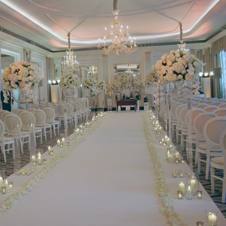 Awesome aisle from wedding at Claridge's. Ivory orchids, hydrangea and poses on perspex plinths.