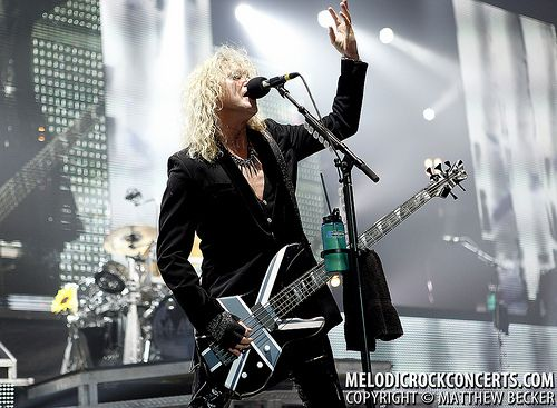 Rick Savage of Def Leppard live on June 26, 2011