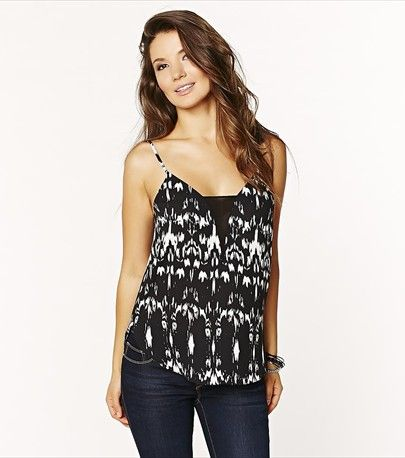 Perfect for cocktails! This cami is both chic and sexy! It features a sheer fabric insert.