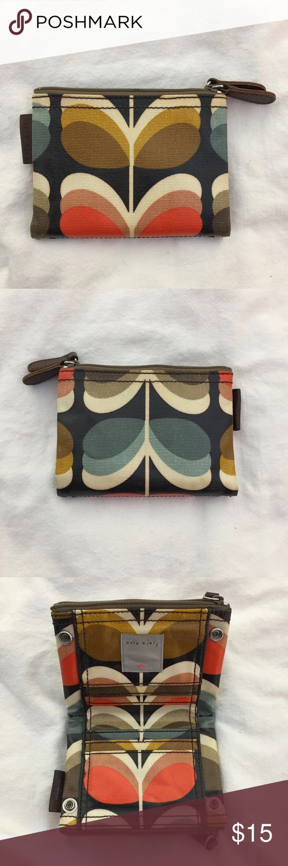 Orla Kiely Wallet Mod Stem Print GUC For sale is a trendy laminated wallet from Orla Kiely in a retro stem and leaf print. Has lots of interior pockets and snaps to keep it securely closed. In good used condition. From a nonsmoking home. Thanks for looking. Orla Kiely Bags Wallets