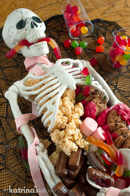 ok wow a halloween dessert table skeleton now that is creepy but what a cool idea for a halloween food theme - Gruesome Halloween Food