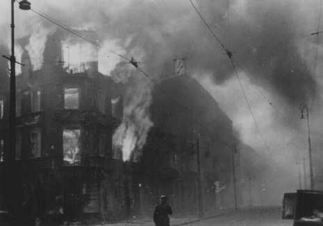 Jewish homes in flames after the Nazis set residential buildings on fire in an effort to force Jews out of hiding during the Warsaw ghetto uprising. Poland, April 19-May 16, 1943.