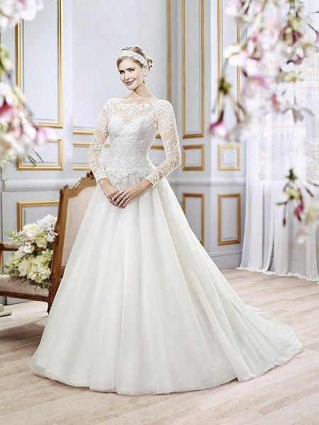 Moonlight Style J6397 A charming tulle ball gown with long illusion sleeves and a plunging V-back. Lace appliques on the bateau neckline and fitted bodice define the curved basque waist. Finished with a chapel train.