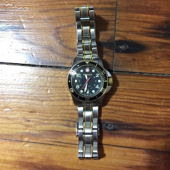 Wenger watch, Swiss Army knife brand Needs new battery, all stainless steel. Some light scratches on the face. Scuff on clasp as pictured. No major scratches on actual watch, just some signs of general use. 7 inch wrist size, sorry, don't have the links that were taken out. Wenger Jewelry