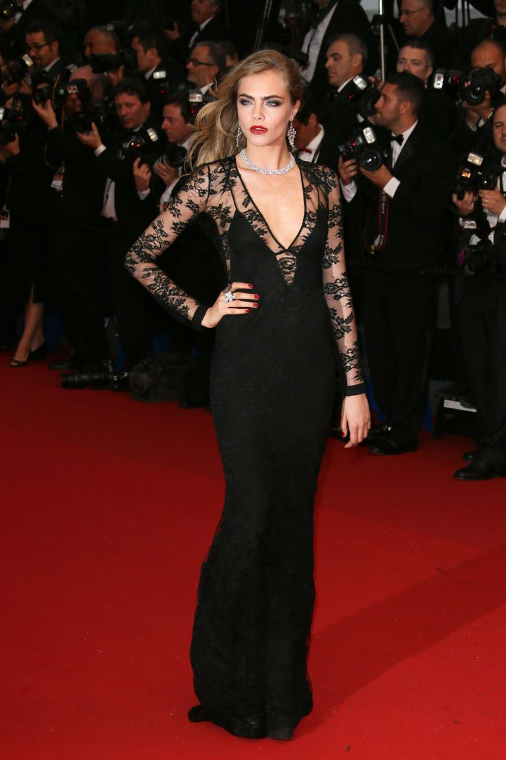 : Cara proved she can pull off a gown with as much ease as she does a baseball cap in this black lace Burberry number.