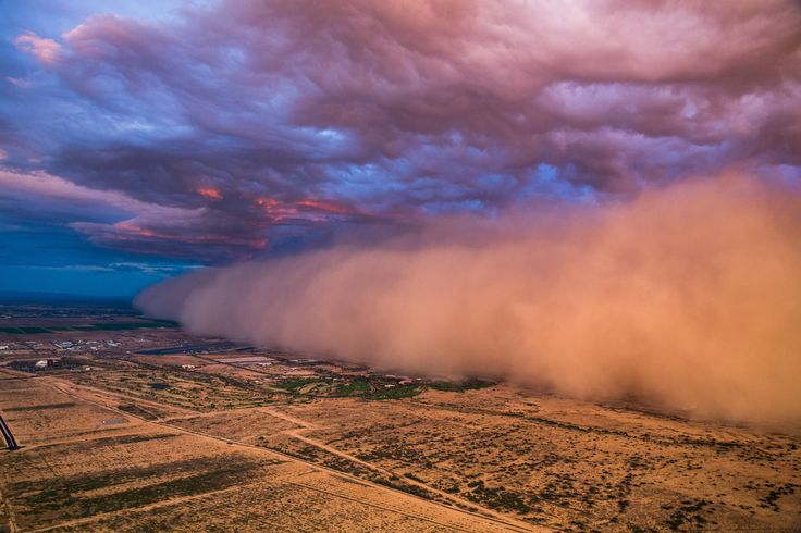 Aerial photos of a dust storm hitting Phoenix at sunset tonight