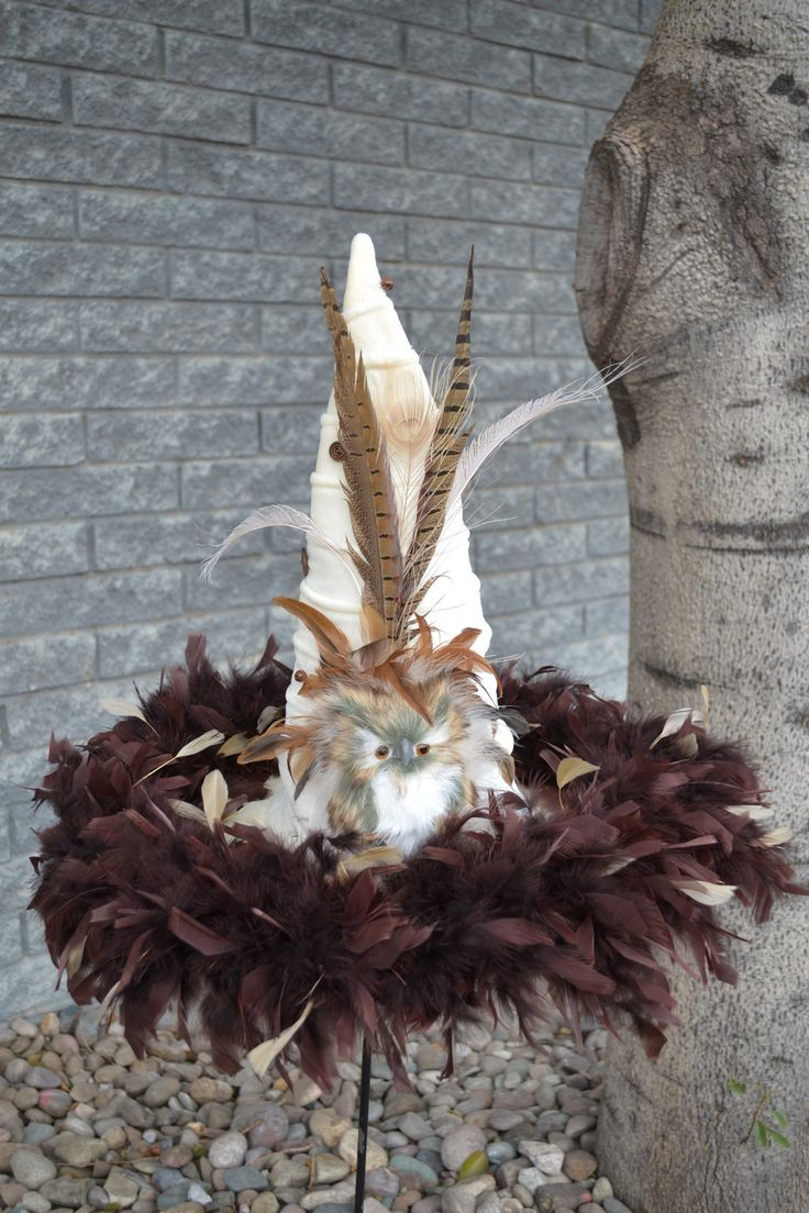 A real show stopper, the owl stands out on this cream colored witch hat. Cream Ridged Velvet 19 inch brim; 19 inch tall. Adjustable inner sizing band.