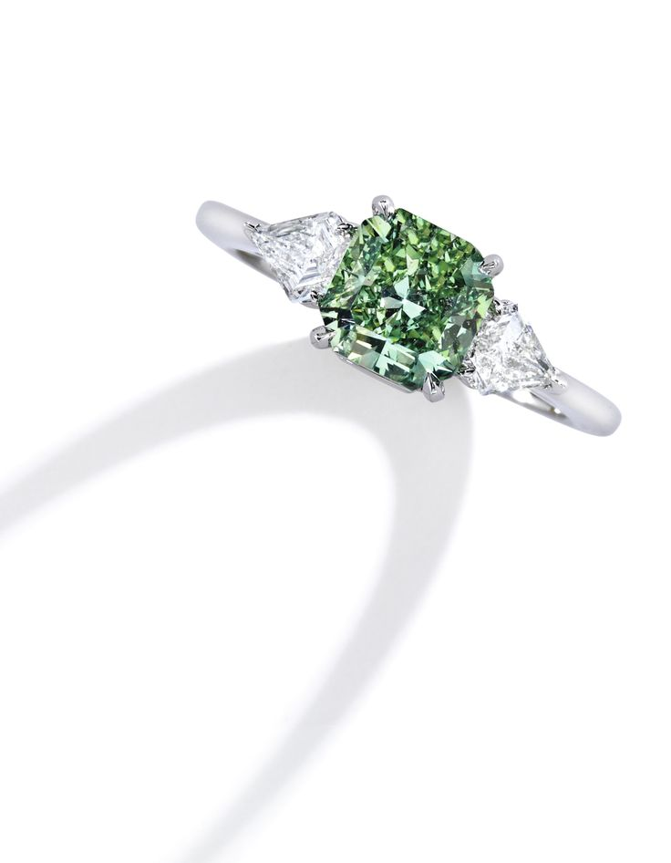 Rare Platinum, Fancy Vivid Green Diamond and Diamond Ring. Centering a 1.64 carat cut-cornered square mixed-cut Fancy Vivid Green diamond, flanked by two cut-cornered triangle-shaped diamonds weighing .65 carat.