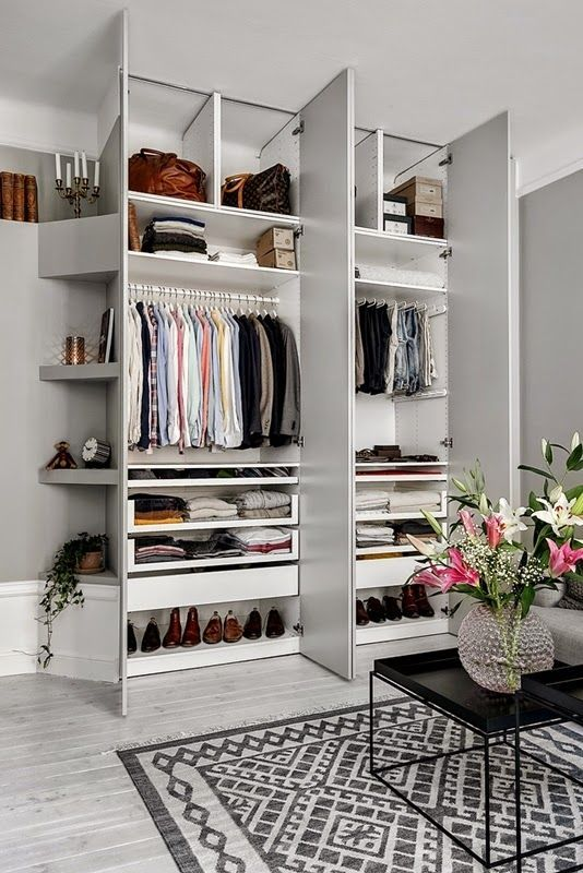 The perfect wardrobe. OK, for a man, but you get the idea. Love the angled skirting board and shelving