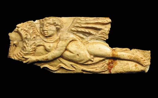 A ROMAN BONE FIGURAL PLAQUE   Egypt, Circa 2nd-4th Century A.D   Depicting a winged Eros flying horizontally to the left offering a wreath  5 1/16 in. (12.9 cm) long