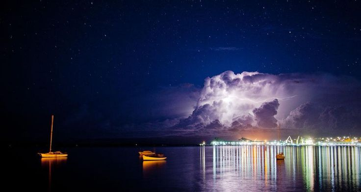 Lightning storm over Port Lincoln with reflections of large storm clouds in waters of Boston Bay, South Australia (© John White Photos/Flickr/Getty Images) (Bing Australia)