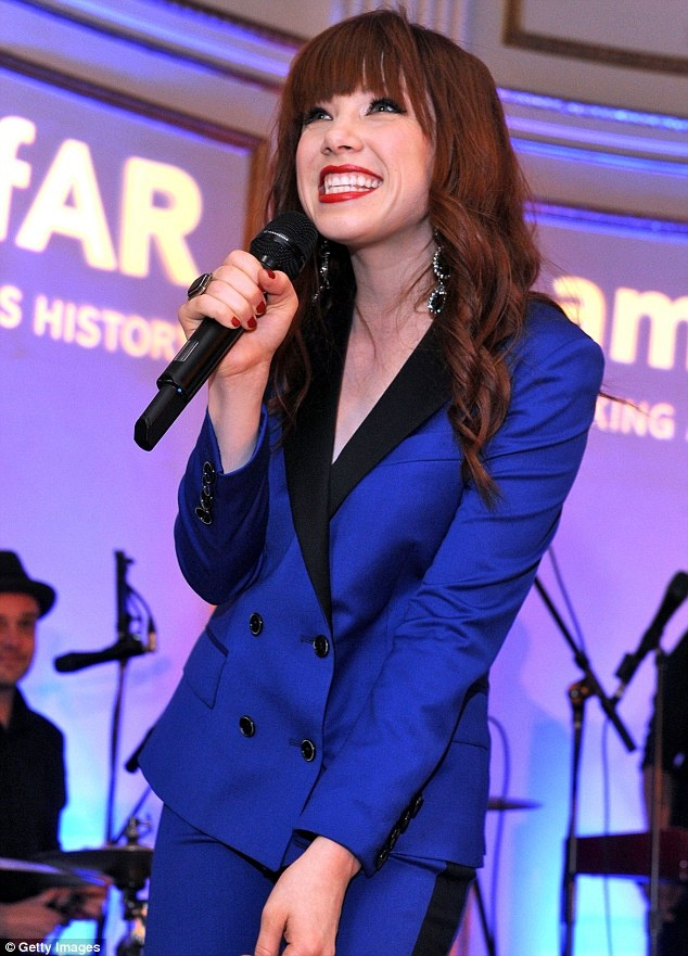 She's electric: Singer Carly Rae Jepsen performed during the 4th Annual amfAR Inspiration Gala in a blue suit
