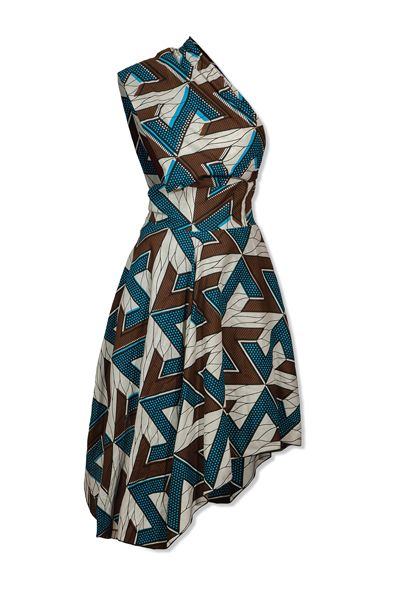 - Funky and versatile dress - Blue geometric cotton print - Can be worn as an asymmetric dress (on either side) or as a halterneck dress as pictured. - Can also be worn as a wrap skirt  One size: fits UK Sizes 8 - 14 (USA Sizes 4 - 10)