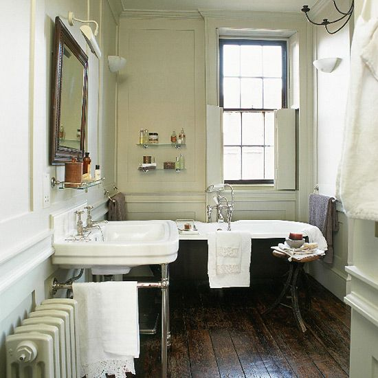 Edwardian Bathroom With Black Clawfoot Tub And Console Sink. Dark floor, black bath. Walls off white (green hint)