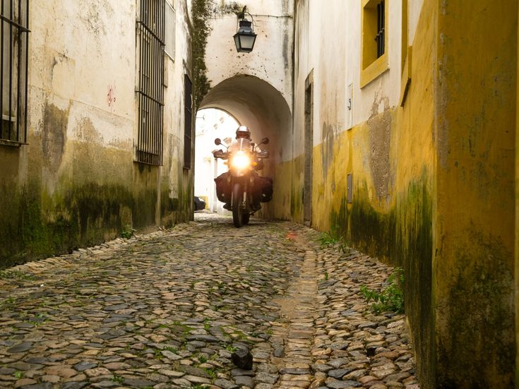 4 Reasons not to visit Portugal - via Piki-Piki 11.05.2015 | For a tiny country 900 years old and only measuring 1200km coastline by about 200km, Portugal packs a massive punch; for mind altering overland experience, a colourful crazy history, and house music loud extrovert fun people. Our initial plan – to rip up this country in a short 2 weeks travelling the coastline – ended up very close to a month crisscrossing the entire country. #portugal #motorcycle #travel #tips Photo: Narrow…