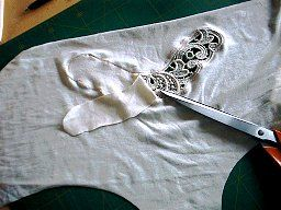 How to insert lace details - be sure to scroll down on the page, the page shows how to insert the lace on underwear (panties, camisoles, etc.) but you could use the same technique on anything (jeans, t-shirts, etc.).