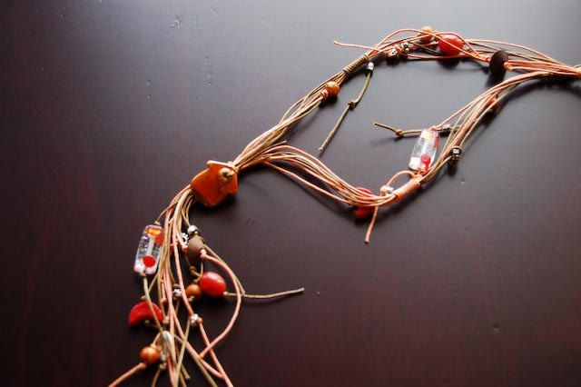 Handmade necklace made of wire, with variety of metal, glass and ceramic beads. by Kosmisis on Etsy