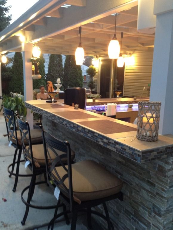 "Outdoor Kitchen - Bar & Patio Cover - Our Little Piece of Paradise...., This is our new Outdoor Kitchen & Bar designed by my husband & I - built by my husband with a little help from his brother and our future son-in-law.  Our design features a matted quartzite wall, stacked stone bar front, tile countertops, pendant track lighting & undercounter LED lighting, a hot & cold sink, ice maker, built-in grill, seating for 6, a wine & beverage center, buffet counter, freezer, refridgerator, 40"" tv…"