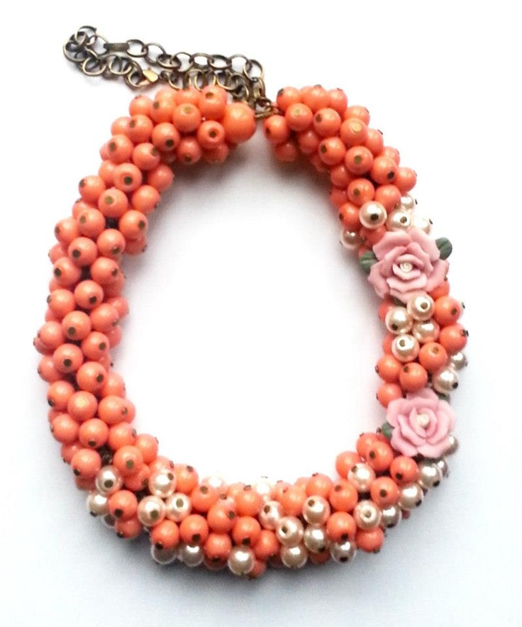 Statement necklace created from white, coral and pink pearls.    www.facebook.com/SimplicitybyMelanie