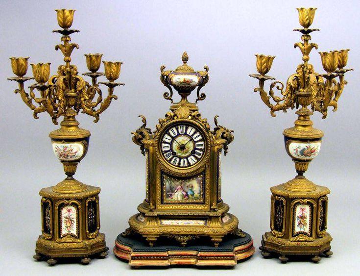 Antique gilt clock and candelabra set