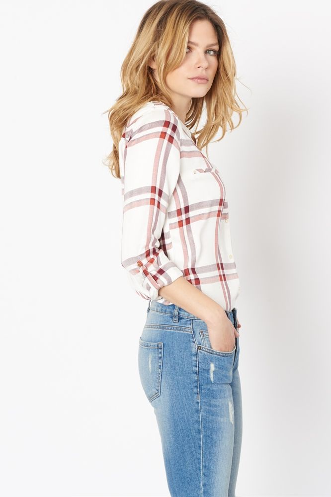 Your workwear and weekend answer to summer chic? This timeless plaid blouse.