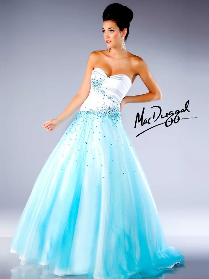 Blue Ball Gown with Sequin Applique on Bust    Mac Duggal  Cool and crisp, this full tulle ballgown is a breath of fresh air. Pleated sweetheart bodice with vine sequined applique on the bust. Crystals dance down bottom of the skirt.