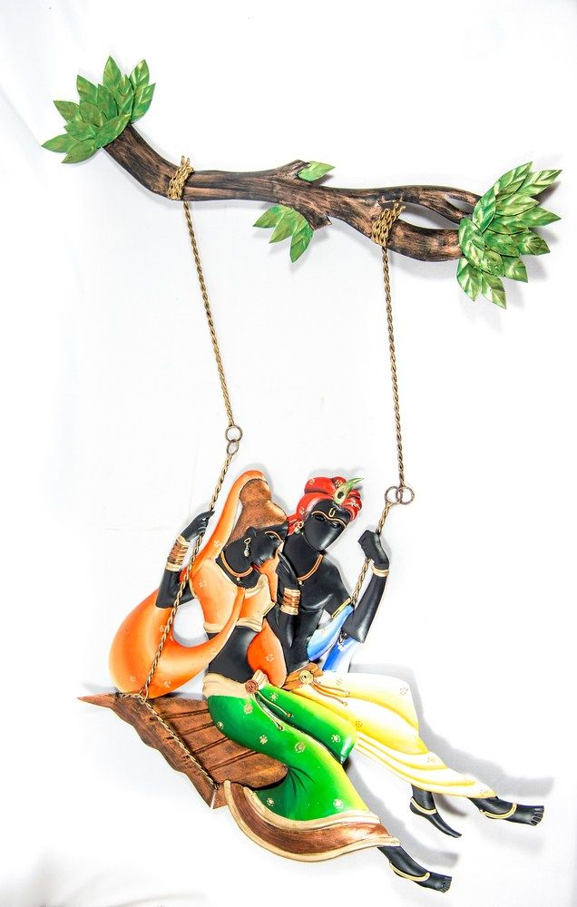 Wrought iron hand painted mural - Colourful Radha Krishna on a swing. General Brand Yashaswini Kalagrah Dimension 31x 22 Inches Material Iron