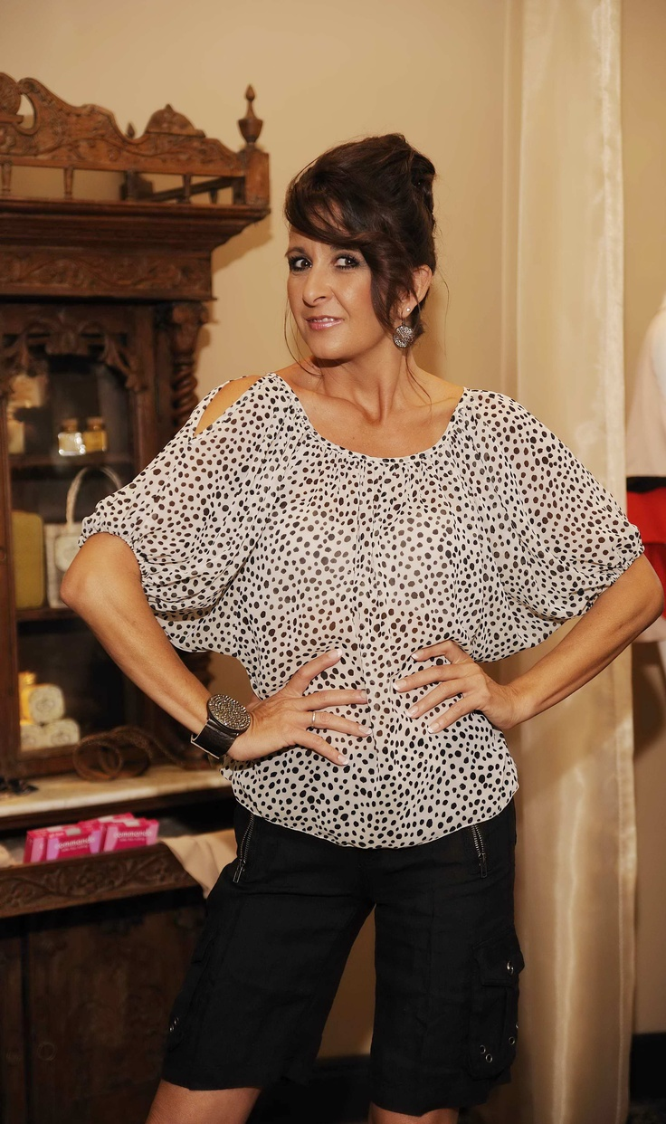 Stacey of Styles Boutique in Boca Raton, FL puts jewelry by Rebel Designs black diamond collection on Model Laura Lee to accessorize a basic linnen short paired with a sheer white top with black polkadots.  The cold shoulder and unequal meandering polkadots make this shirt more unique than a traditional polkadot patterned shirt. Photo Courtesy of Dmitriy Shpurik