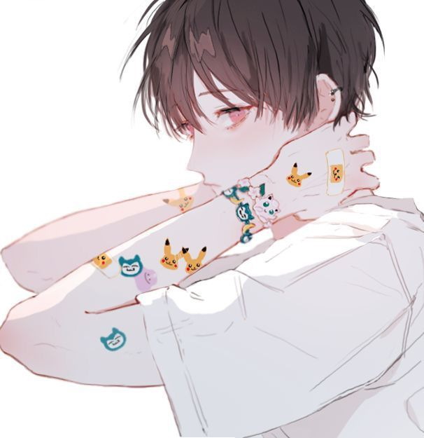Brown haired red eyed boy with Pokemon stickers and white t-shirt