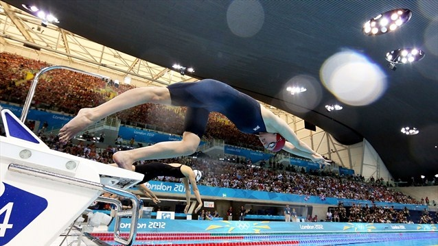 Rebecca Adlington of Great Britain dives off the starting blocks