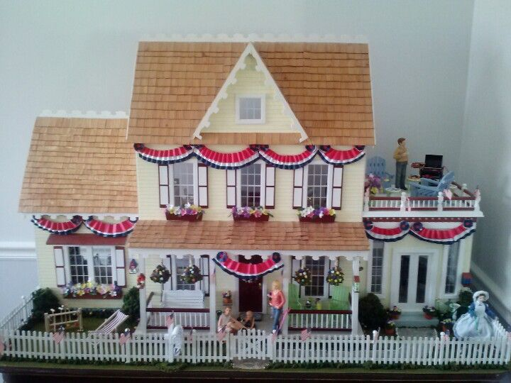 Dollhouse made with the Real Good Toys brand Vermont Jr Farmhouse, main house, and the two story and junior Conservatory additions. All decked out with handmade decorations for the 4th of July!