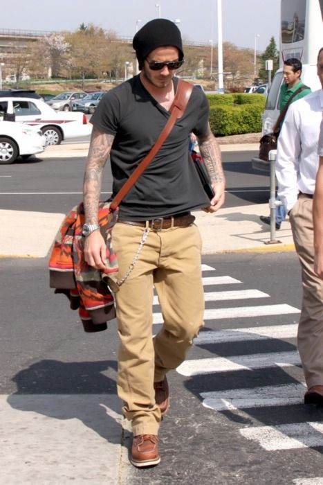 David Beckham, v-neck, satchel, Red Wing 877 boots and tattoos to boot.