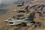 Three US Air Force F-16 Fighting Falcons in formation.