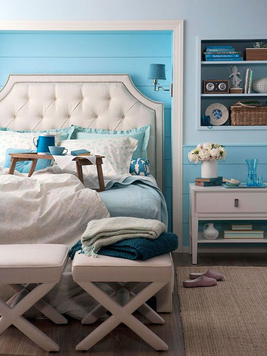 The small alcove with white trim and blue beaded-board panels create the room's focal point.